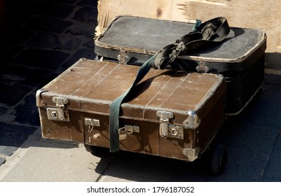 Vintage old classic travel leather suitcases circa the 1940s. Travel luggage concept.