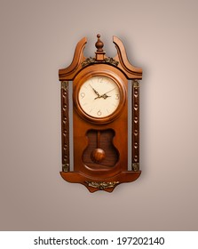Vintage old clock with showing preicse time on the wall