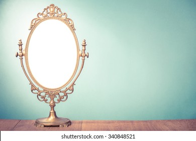 Vintage old desk mirror frame. Retro style filtered photo