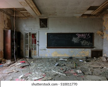 Vintage old destroyed classroom inside abandoned school with chalk board
