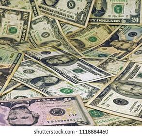 vintage old dollar bills as background.