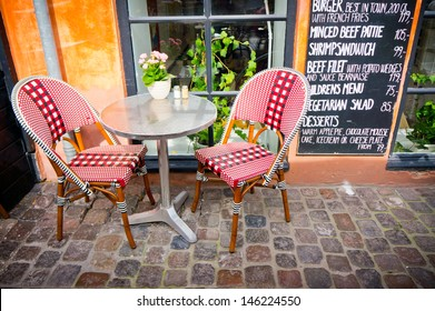 Vintage old fashioned cafe chairs with table in Copenhagen, Denmark