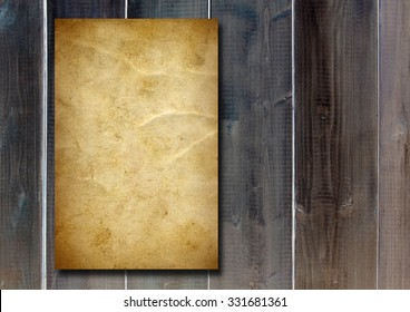 Vintage old grungy paper banner over ancient wood texture background ideal for antique, grunge, texture, retro, aged, ancient, dirty, frame, manuscript or material designs