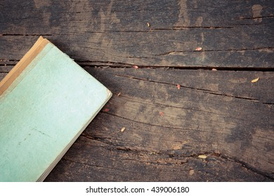 Vintage old Note book on a wood table , process in vintage style