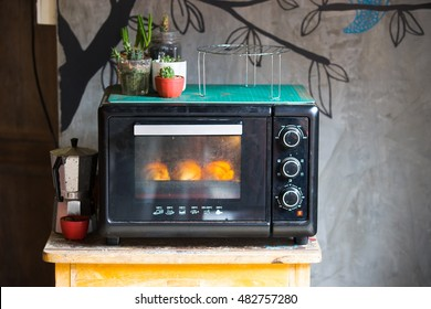 Vintage old oven on a small table