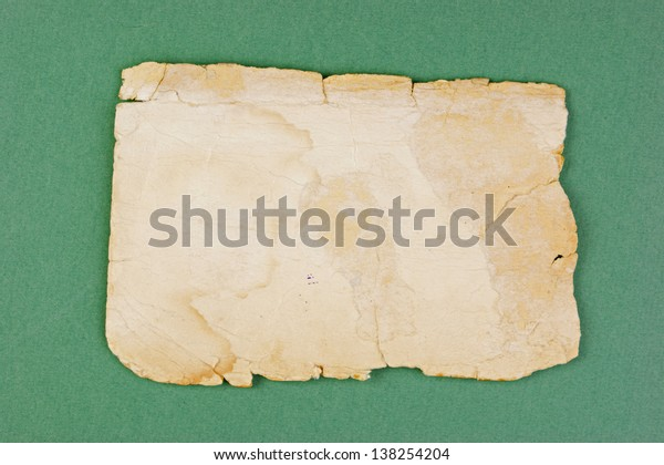 Vintage old paper on the green background