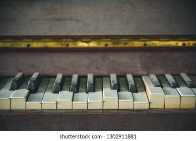 Vintage old piano. Worn piano keys. Black piano close up.