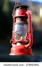 vintage old red lantern with flame