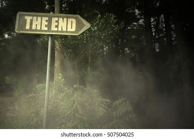 vintage old signboard with text the end near the sinister forest