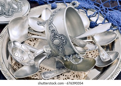 vintage old silverware in a silver tray close-up