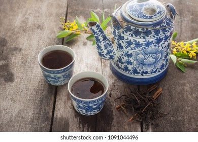 Vintage old stlye chinese tea pot and cup.