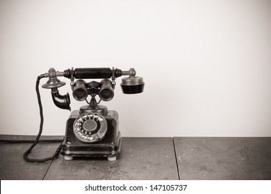 Vintage old telephone with binoculars concept still life