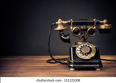 Vintage old telephone with binoculars conceptual still life