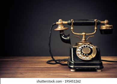 Vintage old telephone front black background
