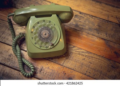 Vintage old telephone on wooden table background