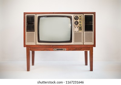 Vintage old television stand on a white background, classic retro old tv technology with wood case.