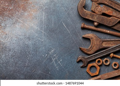 Vintage old tools on stone backdrop. Top view with copy space. Flat lay
