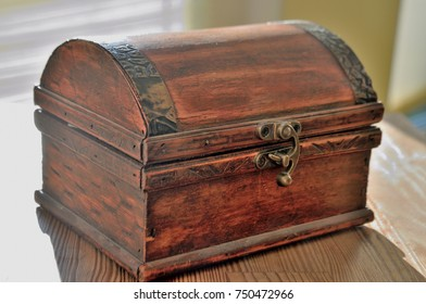 vintage old treasure chest of wood and iron lighting with the sun to the money for good luck
