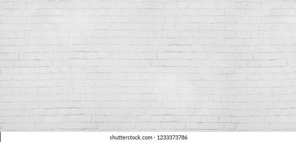 Vintage old white wash brick wall texture. Panoramic background for your text or image