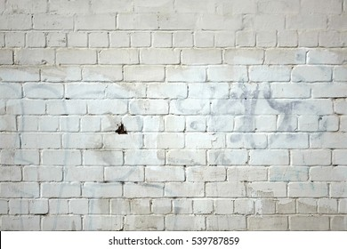 Vintage Old Whitewashed Grafitti Urban Brick Wall Textured Background. White Painted Brickwork Horizontal Texture. Abstract Dark Gray Stonewall Wallpaper.