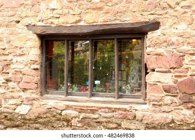 Vintage, old wooden window in stone wall.