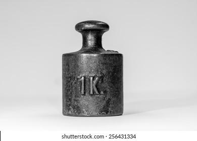 Vintage One Kilogram Iron Calibration Weight on White Background