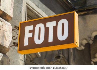 Vintage orange and brown metal store sign of a foto studio in Krakow, Poland
