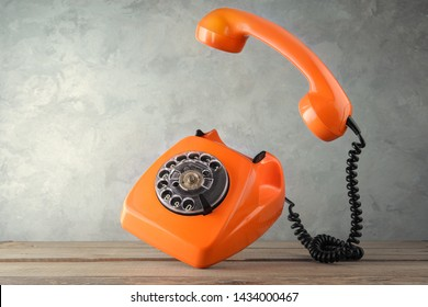 Vintage orange phone - levitate over the table