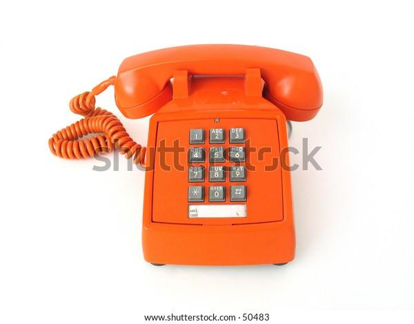 Vintage orange telephone.