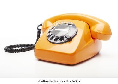 vintage orange telephone isolated over white background