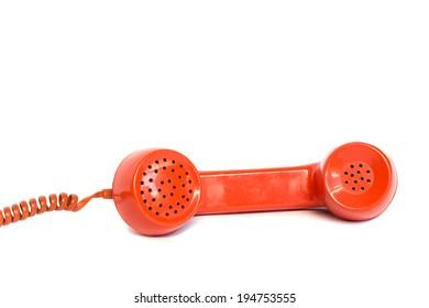 Vintage orange telephone receiver isolated on white background