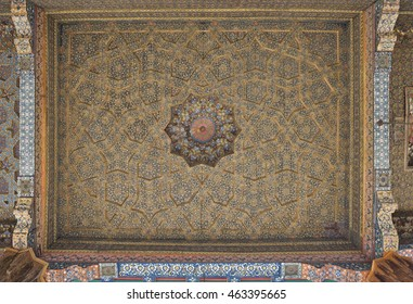 Vintage oriental patterns decorate the ceiling in Bukhara.