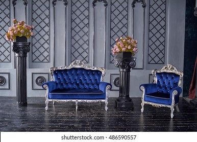 Vintage original interior of the room. The old blue couch and chair