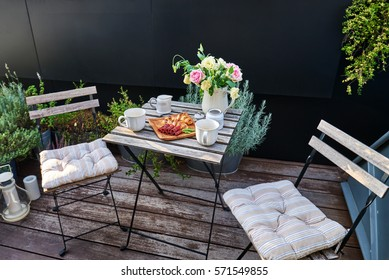 Vintage outdoor coffee table in cafe wooden terrace.