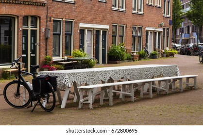 Vintage outdoor dining table in Amsterdam - outdoor cafe table with bicycle