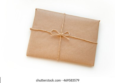 Vintage package tied up with string isolated on a white background