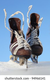 vintage pair of mens  skates on the ice