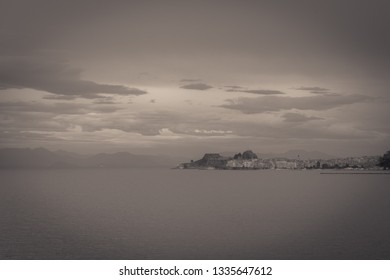 Vintage panorama of the city of Corfu with the harbor on a rainy day, Greece