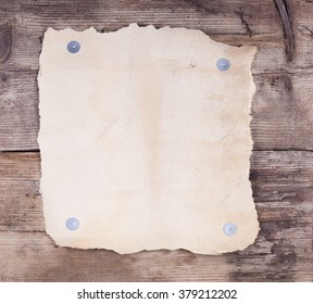 vintage paper blank on wooden background