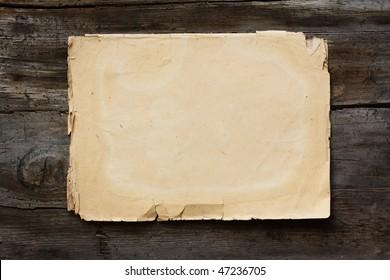 vintage paper on old wood texture
