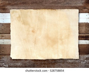 Vintage paper texture on wooden background.
