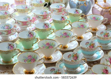 vintage pastel tea cups on saucers in rows - high tea party