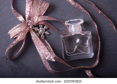 Vintage perfume bottle with minerals and sparkle bow/ Special toning/ amethyst and pink quartz/ shale dark background