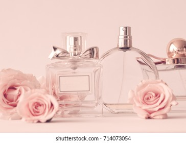 Vintage perfume bottles and roses