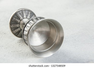 Vintage pewter goblet on concrete background. Copy space for text