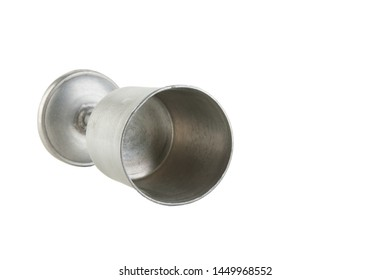 Vintage pewter goblet on white background. Copy space for text