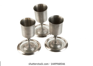 Vintage pewter goblets isolated on white background. Copy space for text