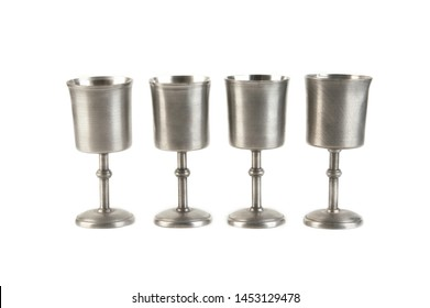 Vintage pewter goblets on white background. Copy space for text