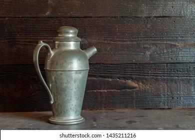 Vintage pewter martini shaker on table