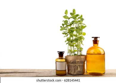 Vintage pharmacy bottles and medical herb isolated on white